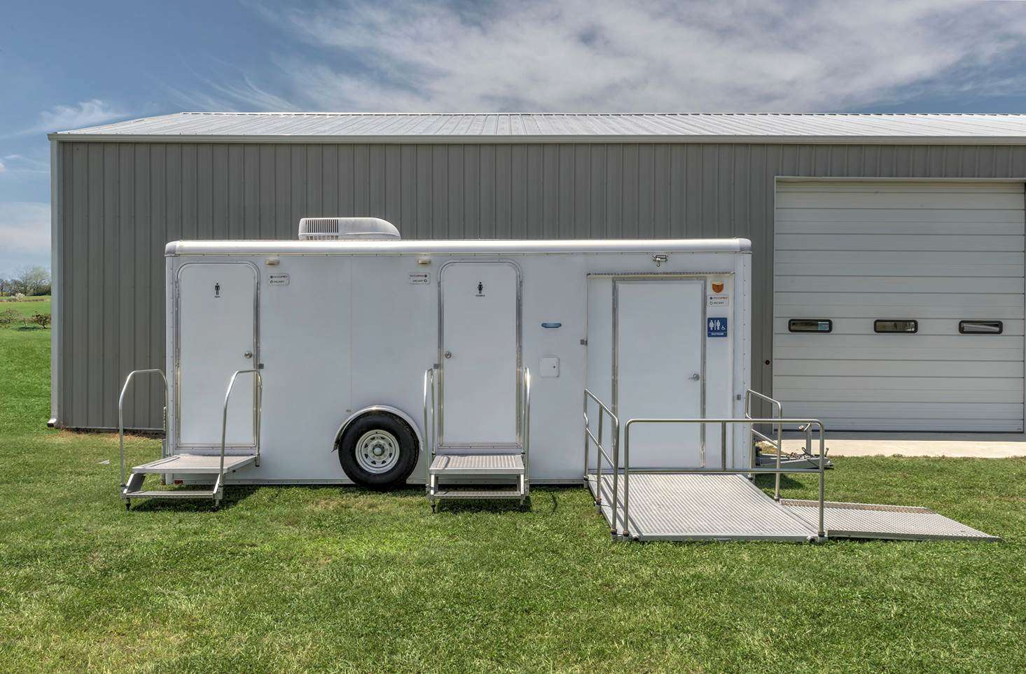 Portable restroom trailers easy rental blu site solutions for Portable bathroom trailers